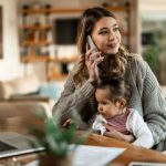 Mortgage borrower at home on phone with loan servicing team