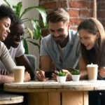 millennial group review mortgage lender on smart phone