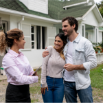 mortgage originator talks with mortgage borrowers outside home