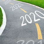 Foot path with years 2019, 2020, 2021 and 2022 painted on the path illustrating article Prepare to Thrive in a Purchase Driven Market
