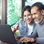 Happy Mortgage Borrowers using computer to access lender website