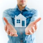 mortgage lender retaining servicing holds house in his hands
