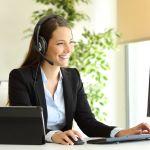 Woman loan processor on headset speaking with customer